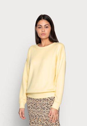 IMA - Sweatshirt - pale banana