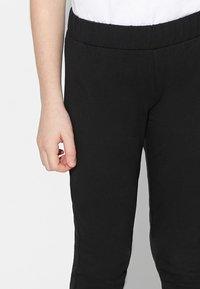 Tezenis - Leggings - Trousers - nero - 3