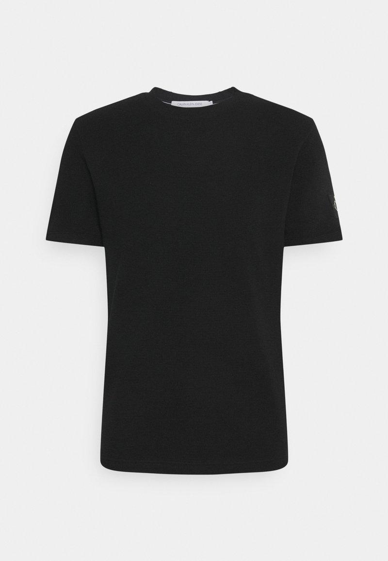Calvin Klein Jeans - MONOGRAM BADGE WAFFLE TEE - Print T-shirt - black