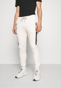 CLOSURE London - TAPED JOGGER - Pantalon de survêtement - off white - 0