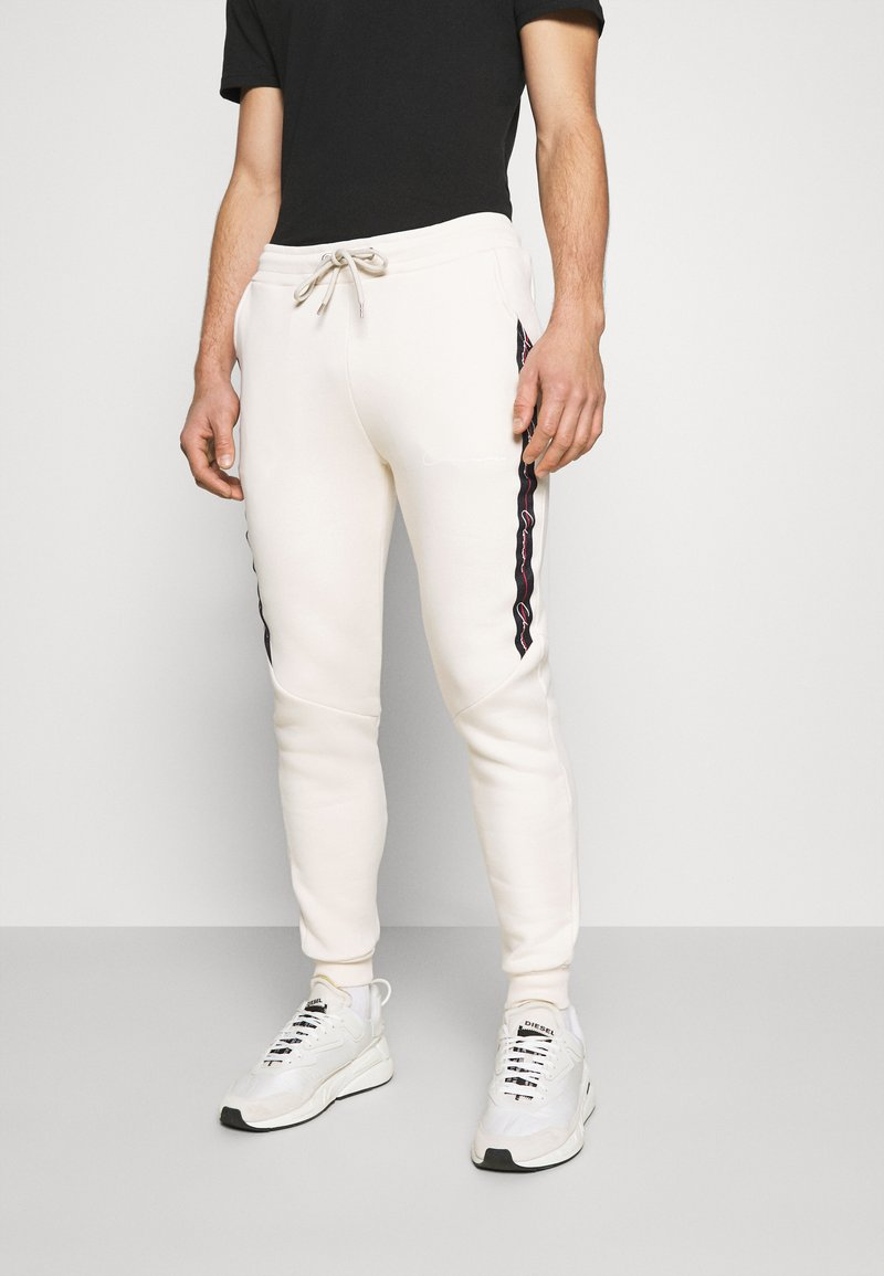 CLOSURE London - TAPED JOGGER - Pantalon de survêtement - off white