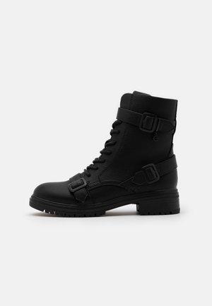 FÉLINN - Lace-up ankle boots - black
