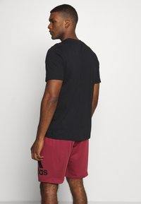 adidas Performance - ESSENTIALS SPORTS SHORT SLEEVE TEE - T-shirt con stampa - black - 2
