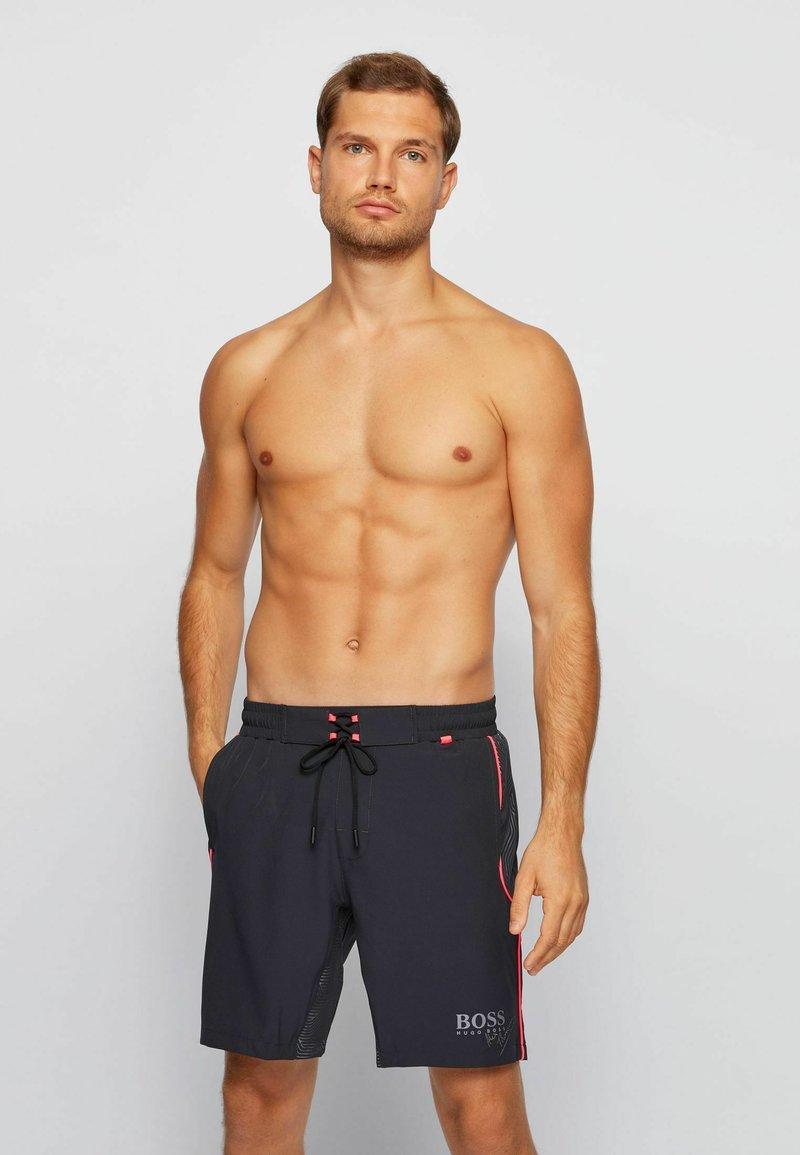 BOSS - Swimming shorts - black