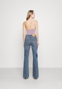 BDG Urban Outfitters - RIP AND REPAIR - Flared jeans - mid vintage - 2