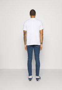 Lee - LUKE - Slim fit jeans - mid stone wash - 2