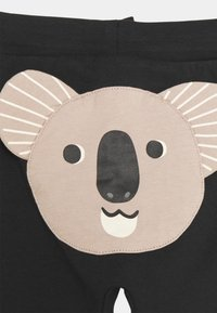 Lindex - TROUSERS KOALA BEAR AT BACK UNISEX - Trousers - off black - 2