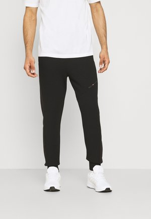 BLOCKED TERRY PANT - Tracksuit bottoms - black