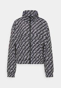 Calvin Klein Jeans - PACKABLE HOOD WINDBREAKER - Summer jacket - black - 6
