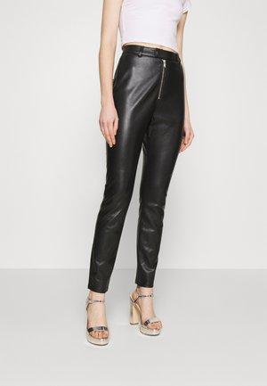 ZIPPER PANTS - Trousers - black