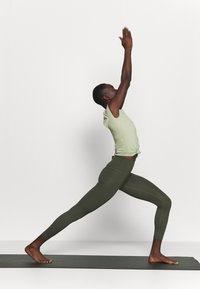 Nike Performance - THE YOGA LUXE - T-shirts - celadon/olive aura - 1