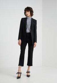By Malene Birger - VIGGIE - Trousers - black - 1