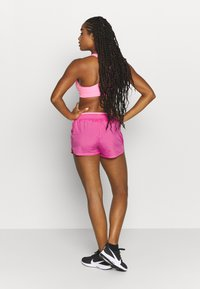 Nike Performance - RUN SHORT - Pantalón corto de deporte - pink glow/white - 2