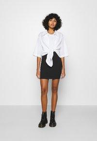 Even&Odd - 2 PACK - Minifalda - black/camel - 0