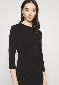 Vero Moda - VMMELINDA DETAIL DRESS - Jerseykjole - black - 4