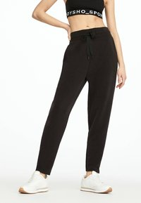 OYSHO - Pantalon de survêtement - black - 1
