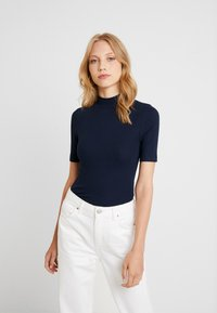 Tommy Hilfiger - DORY HIGH  - Basic T-shirt - blue - 0