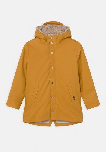 SNAKE PIT 2-IN-1 UNISEX - Winter jacket - golden yellow