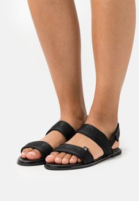 Calvin Klein Jeans - FLAT TWOSTRAPS  - Sandals - black - 0