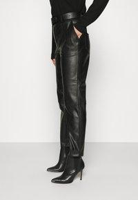 NIKKIE - MELLA PANTS - Trousers - black - 3