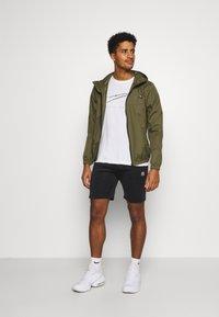 Ellesse - KEAN - Sports shorts - black - 1