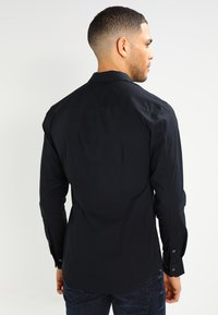 Tommy Jeans - ORIGINAL STRETCH SLIM FIT - Košile - black - 2