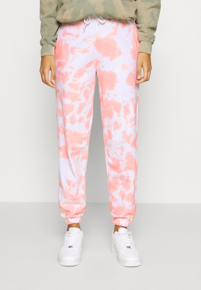 New Look - TIE DYE JOGGERS - Tracksuit bottoms - mid pink