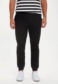 DeFacto - Pantalones deportivos - black - 0