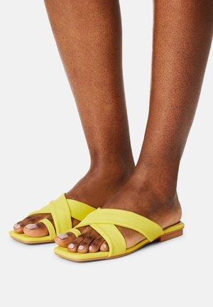ALIVIA - T-bar sandals - yellow