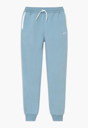 ORDINATE - Tracksuit bottoms - blue/reflective white
