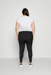 Nike Sportswear - Leggings - Trousers - black - 2