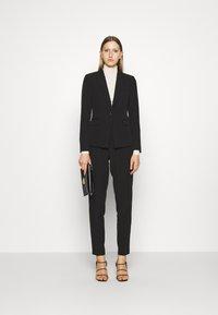 Bruuns Bazaar - RUBY VIGGA PANT - Trousers - black - 1