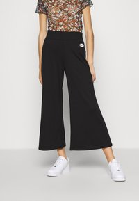 Nike Sportswear - Trousers - black/white - 0