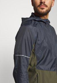 Salomon - AGILE HOODIE - Outdoor jacket - olive night/ebony - 6