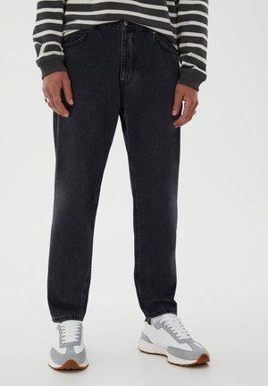 STANDARD  - Straight leg jeans - black