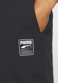 Puma - REBEL PANTS BLOCK - Tracksuit bottoms - black - 5