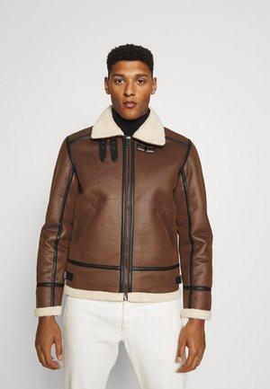 JORROCCO  - Faux leather jacket - almond
