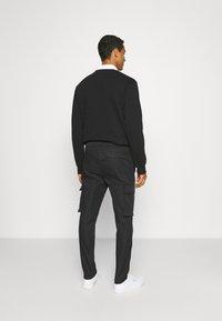 Samsøe Samsøe - SMITHY TROUSERS - Cargo trousers - black - 2