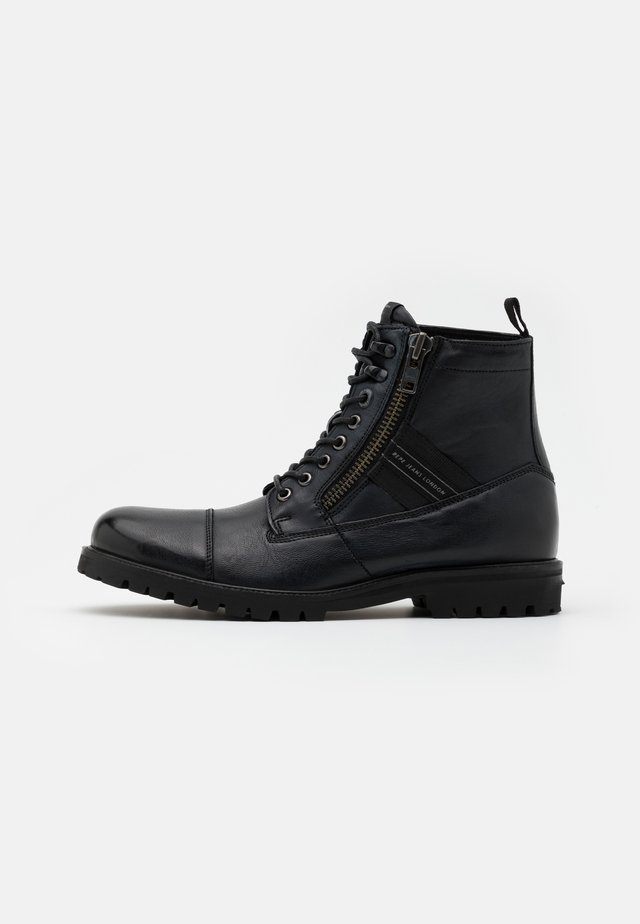 MELTING TAPE MAN - Lace-up ankle boots - black
