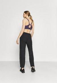 Nike Performance - PANT - Tracksuit bottoms - black/metallic silver - 2