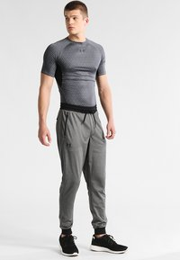 Under Armour - SPORTSTYLE - Tracksuit bottoms - carbon heather - 1