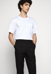 Filippa K - TERRY CROPPED SLACKS - Trousers - black - 3