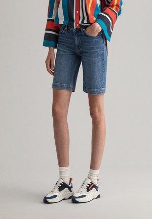 Denim shorts - light blue worn in