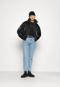 Calvin Klein Jeans - ZIP THROUGH - Windbreaker - black - 1