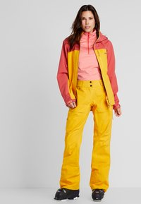PYUA - RELEASE - Snow pants - pumpkin yellow - 1