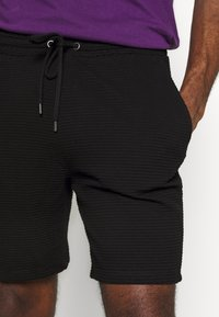 Topman - STRUCTURED - Tracksuit bottoms - black - 4