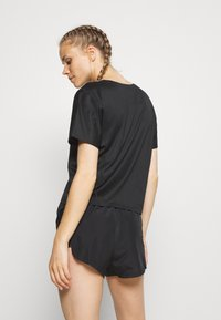Nike Performance - CITY SLEEK - Basic T-shirt - black/white - 2
