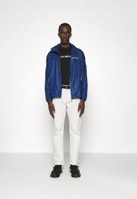 Emporio Armani - BLOUSON JACKET - Summer jacket - blu navy - 1