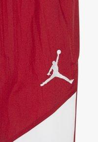 Jordan - WINGS SIDELINE PANT - Tracksuit bottoms - gym red - 3