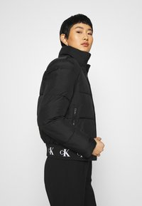 Calvin Klein Jeans - REPEATED LOGO PUFFER - Winter jacket - black - 3